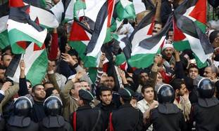 Demonstrators protest against Israeli air strikes in Gaza, in front of journalists' syndicate in Cairo