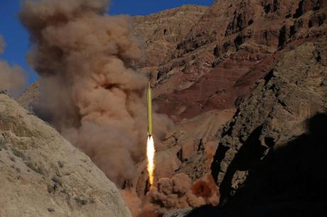 "In this photo obtained from the Iranian Fars News Agency, a Qadr H long-range ballistic surface-to-surface missile is fired by Iran's powerful Revolutionary Guard, during a maneuver, in an undisclosed location in Iran, Wednesday, March 9, 2016. Iran's powerful Revolutionary Guard test-fired two ballistic missiles Wednesday with the phrase ""Israel must be wiped out"" written on them, a show of deterrence power by the Islamic Republic as U.S. Vice President Joe Biden visited Israel, the semi-official Fars news agency reported. (AP Photo/Fars News Agency, Omid Vahabzadeh)"